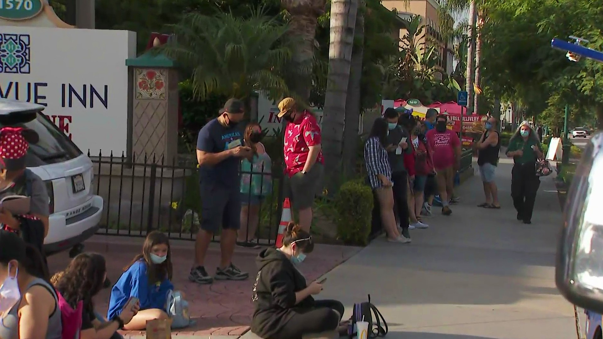 Guests lineup hours before the opening of Downtown Disney in Anaheim on July 9, 2020. (KTLA)