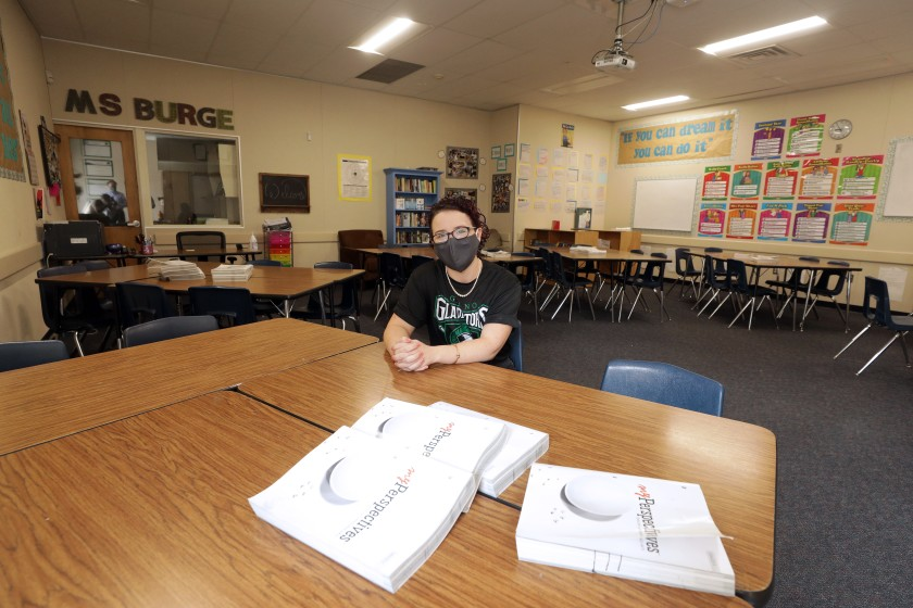 Natalie Burge, a teacher at Giano Intermediate School in West Covina, sits in her empty classroom. Officials are debating whether to reopen campuses in the fall. (Myung J. Chun / Los Angeles Times)