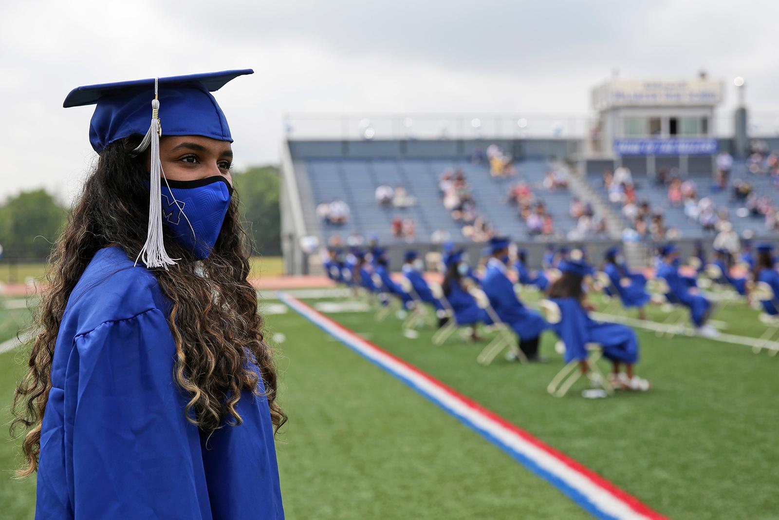 A student prepares to walk in a graduation ceremony at Millburn High School in Millburn, N.J., Wednesday, July 8, 2020. (Seth Wenig/AP via CNN Wire)