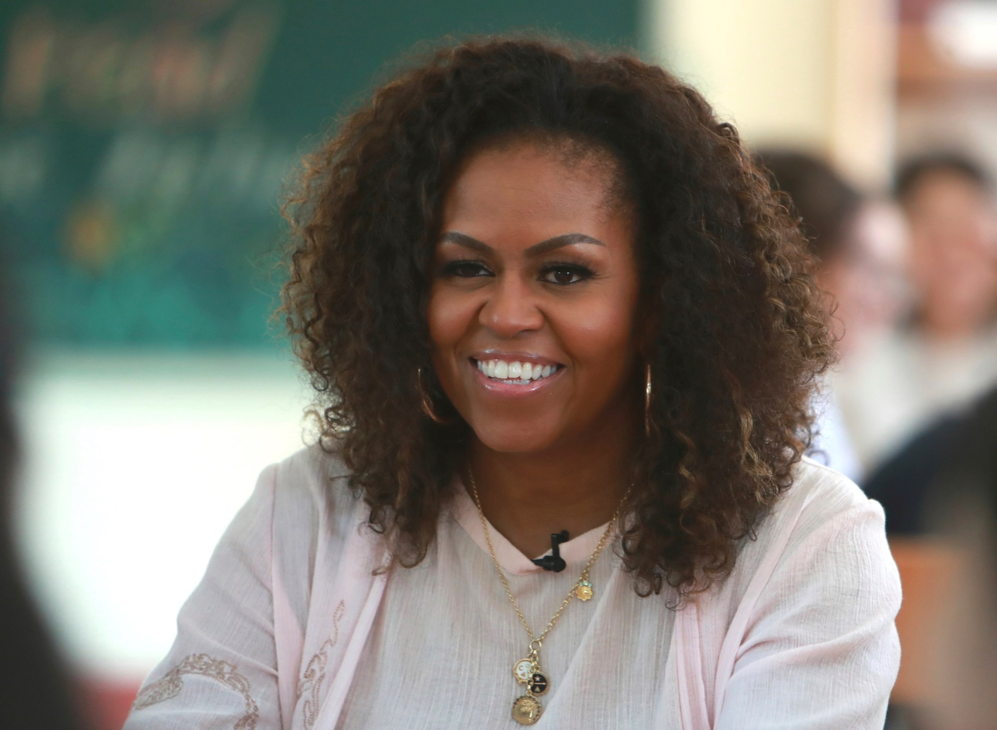 "In this Dec. 9, 2019, file photo, Michelle Obama listens to female students at the Can Giuoc high school in Long An province, Vietnam. Higher Ground--a production company founded by Barack and Michelle Obam--and Spotify announced Thursday, July 16, 2020, that the former first lady will host ""The Michelle Obama Podcast"" on the streaming service. The podcast will debut exclusively on Spotify on July 29 (AP Photo/Hau Dinh, File)"