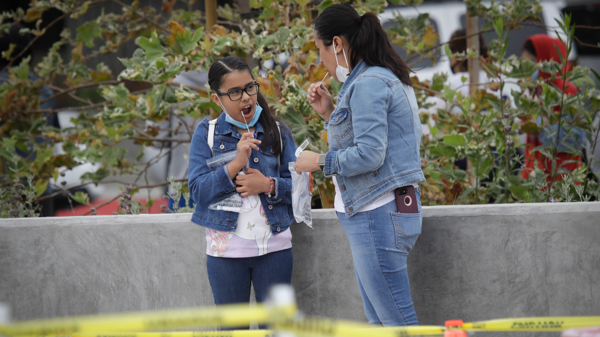 A woman and girl take a coronavirus test together in Los Angeles on July 22, 2020. (Marcio Jose Sanchez / Associated Press)