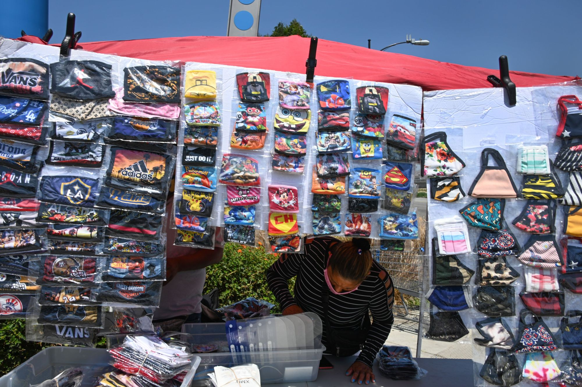 A vendor sells masks outside a Walmart store, July 22, 2020 in Burbank. (ROBYN BECK/AFP via Getty Images)