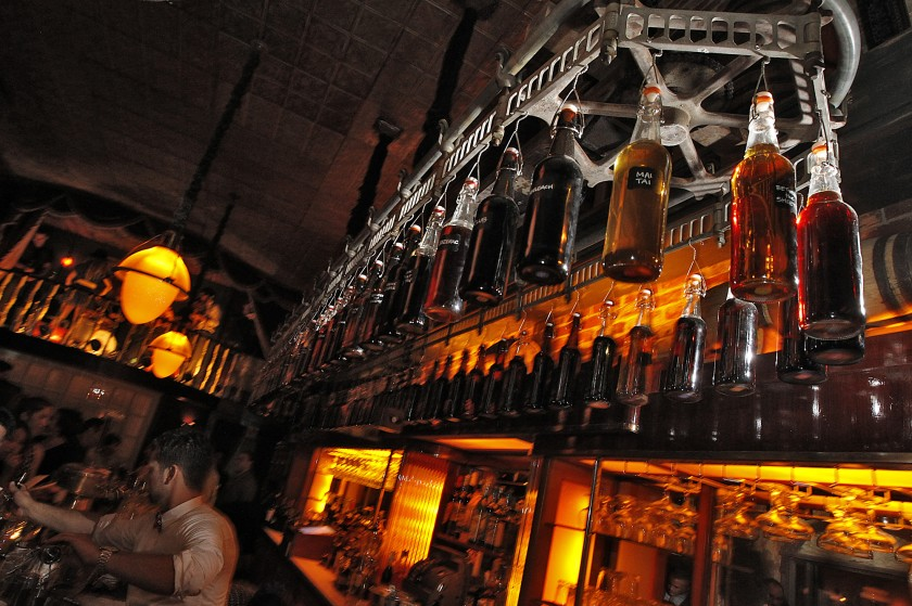 Bottles hang from a rotating delivery mechanism over the bar at Club Sassafras in this undated photo. (Robert Gauthier / Los Angeles Times)