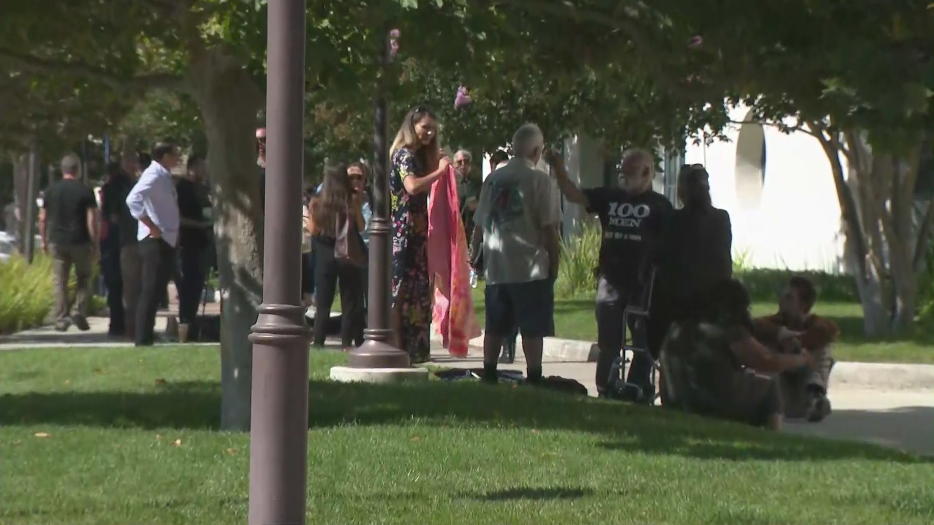 People stand outside the Godspeak Calvary Chapel in Ventura County's Newbury Park on Aug. 9, 2020. (KTLA)