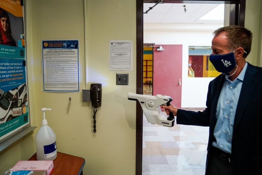Los Angeles Unified School District Supt. Austin Beutner demonstrates the use of sanitizing tools while taking a tour of Burbank Middle School in this undated photo. (Kent Nishimura / Los Angeles Times)
