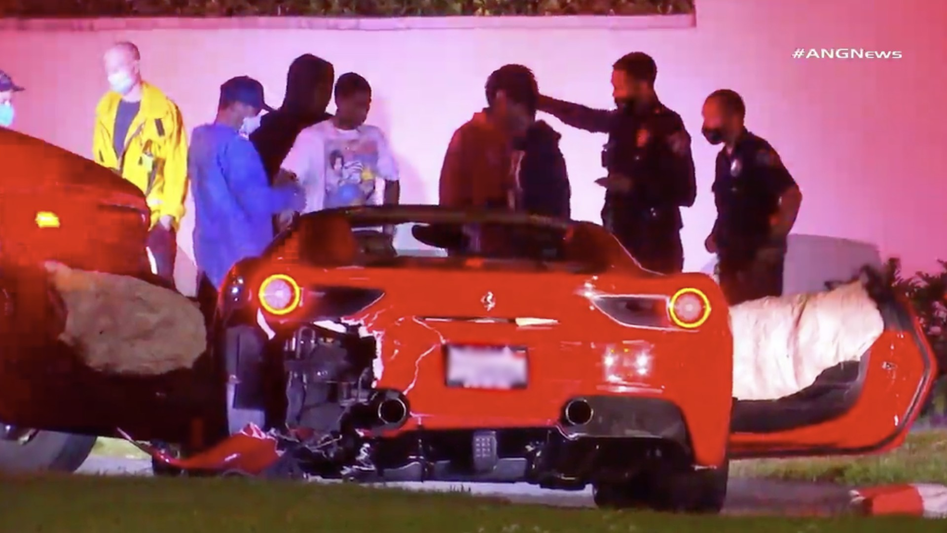 People stand around following a crash involving a Ferrari and a Tesla in Beverly Hills on Aug. 5, 2020. (RMG News)