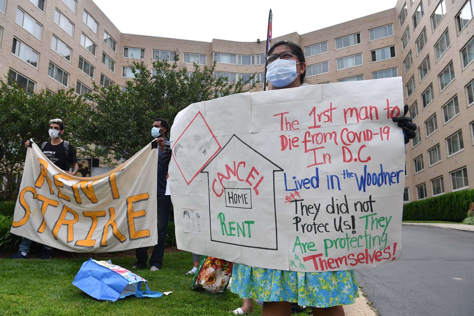 Renters of the Woodner apartment building in Washington, DC, protest to demand their rent be forgiven during the COVID-19 pandemic on May 28, 2020. (NICHOLAS KAMM/AFP via Getty Images)