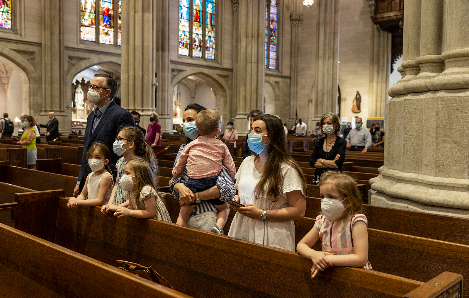 A family prays during St. Patrick's Cathedral's first public Mass since March on June 28, 2020, in New York. (Lev Radin/Pacific Press/LightRocket via Getty Images via CNN)