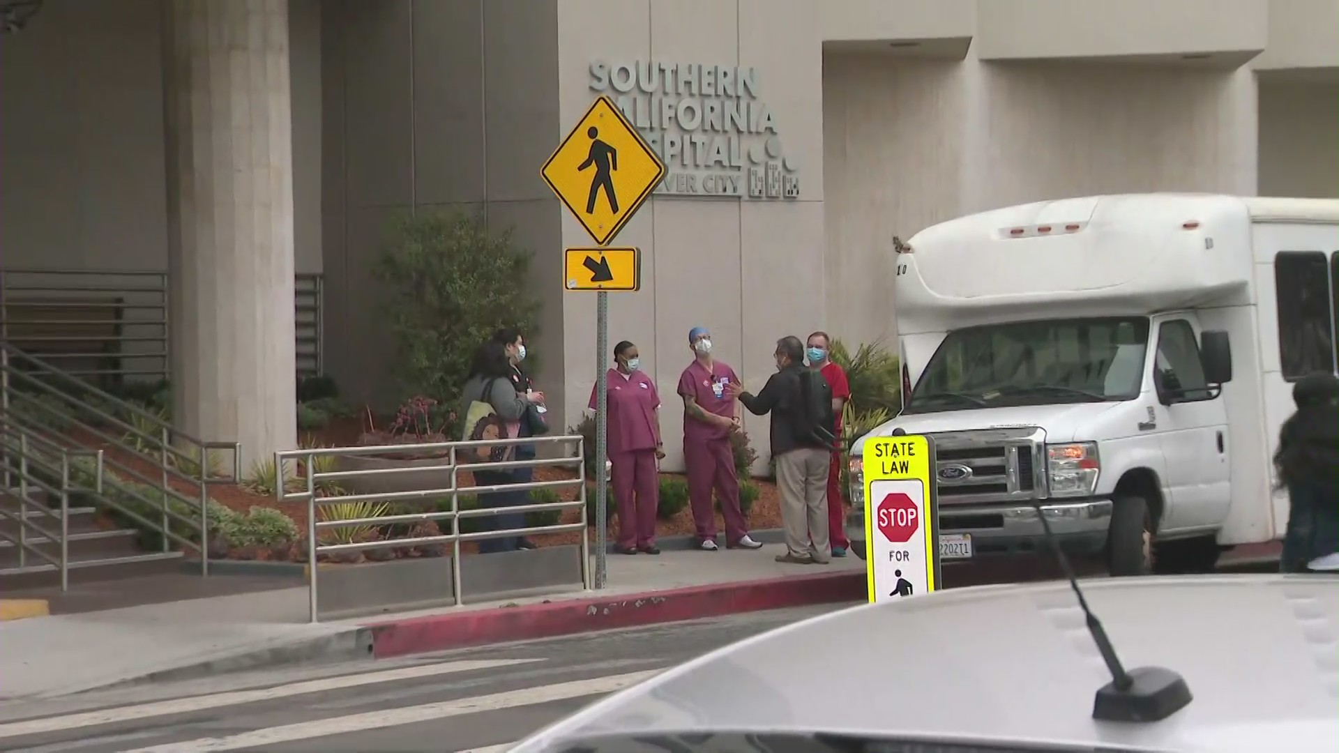 Nurses begin to gather for a rally to demand better COVID-19 safety. (KTLA)