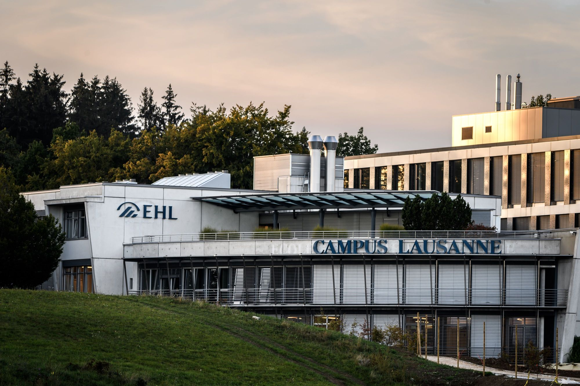 A picture taken on September 23, 2020 above Lausanne shows the EHL Hospitality Management School of Lausanne in which some 2500 students have been placed in quarantine after several outbreaks of coronavirus were reported there following private parties. (FABRICE COFFRINI/AFP via Getty Images)