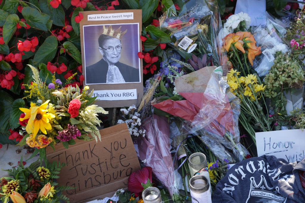 Signs and flowers are left at a makeshift memorial in front of the U.S. Supreme Court for the late Justice Ruth Bader Ginsburg Sept. 21, 2020 in Washington, D.C. (Alex Wong/Getty Images)