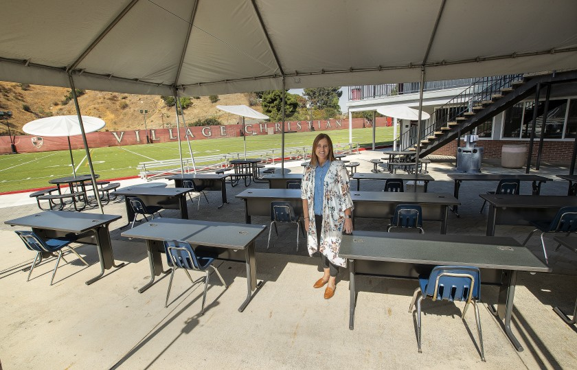 Dana Mikels, principal of Village Christian School in Sun Valley, is photographed in September 2020 at an outdoor classroom that would seat one student per table. (Mel Melcon / Los Angeles Times)