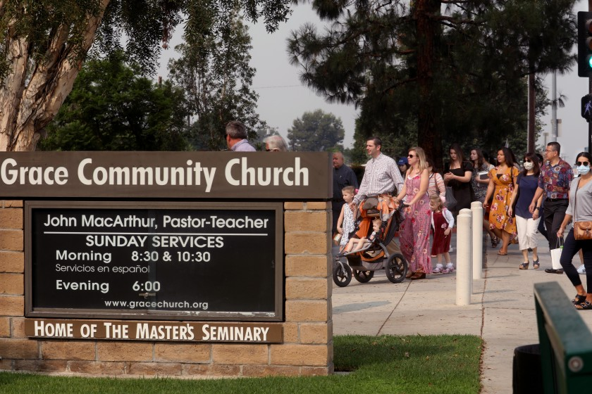 People head to Sunday service at Grace Community Church in Sun Valley on Sept. 13, 2020, amid the COVID-19 pandemic. (Genaro Molina / Los Angeles Times)