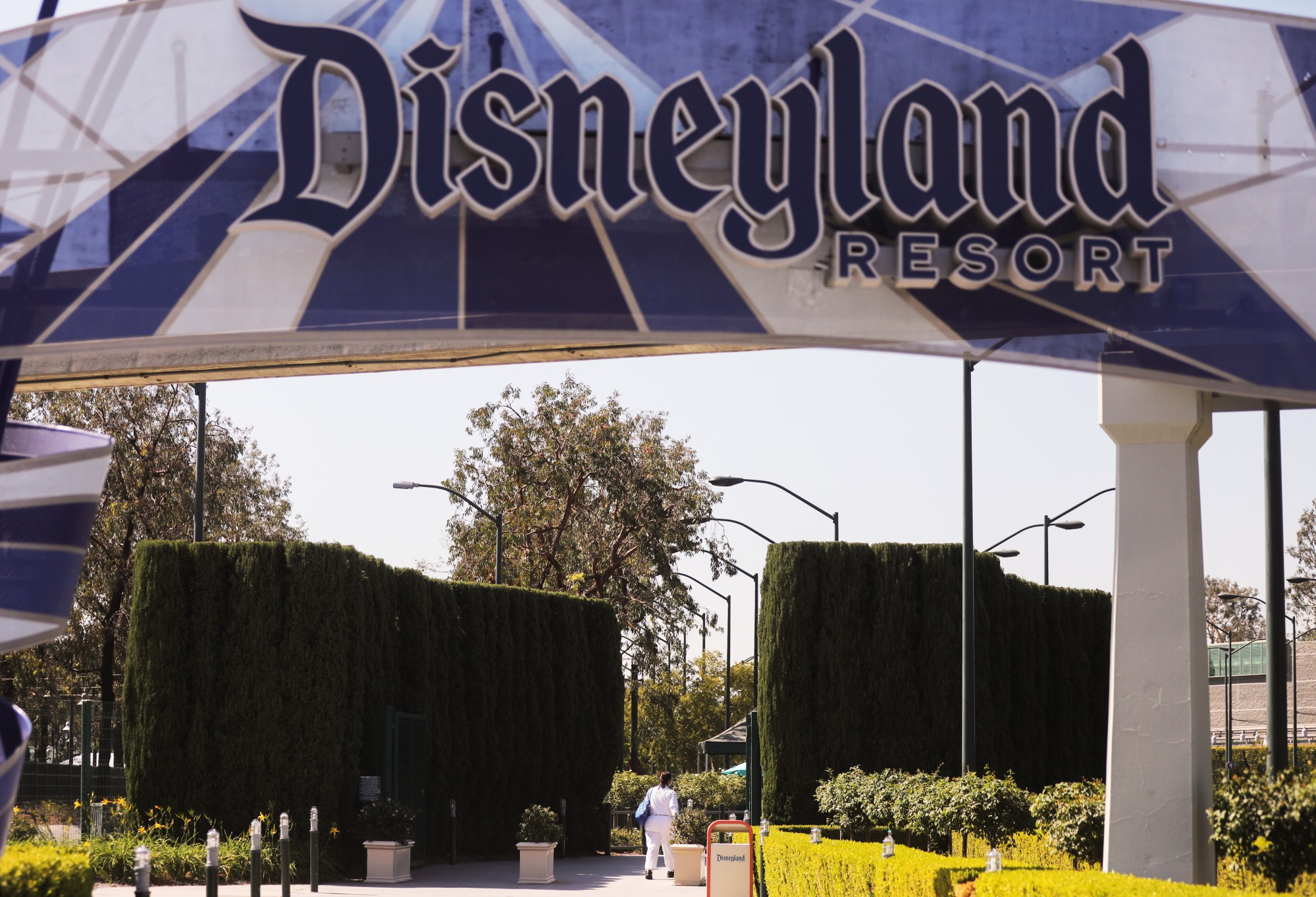 A person walks into an entrance to Disneyland in Anaheim on Sept. 30, 2020. (Mario Tama / Getty Images)