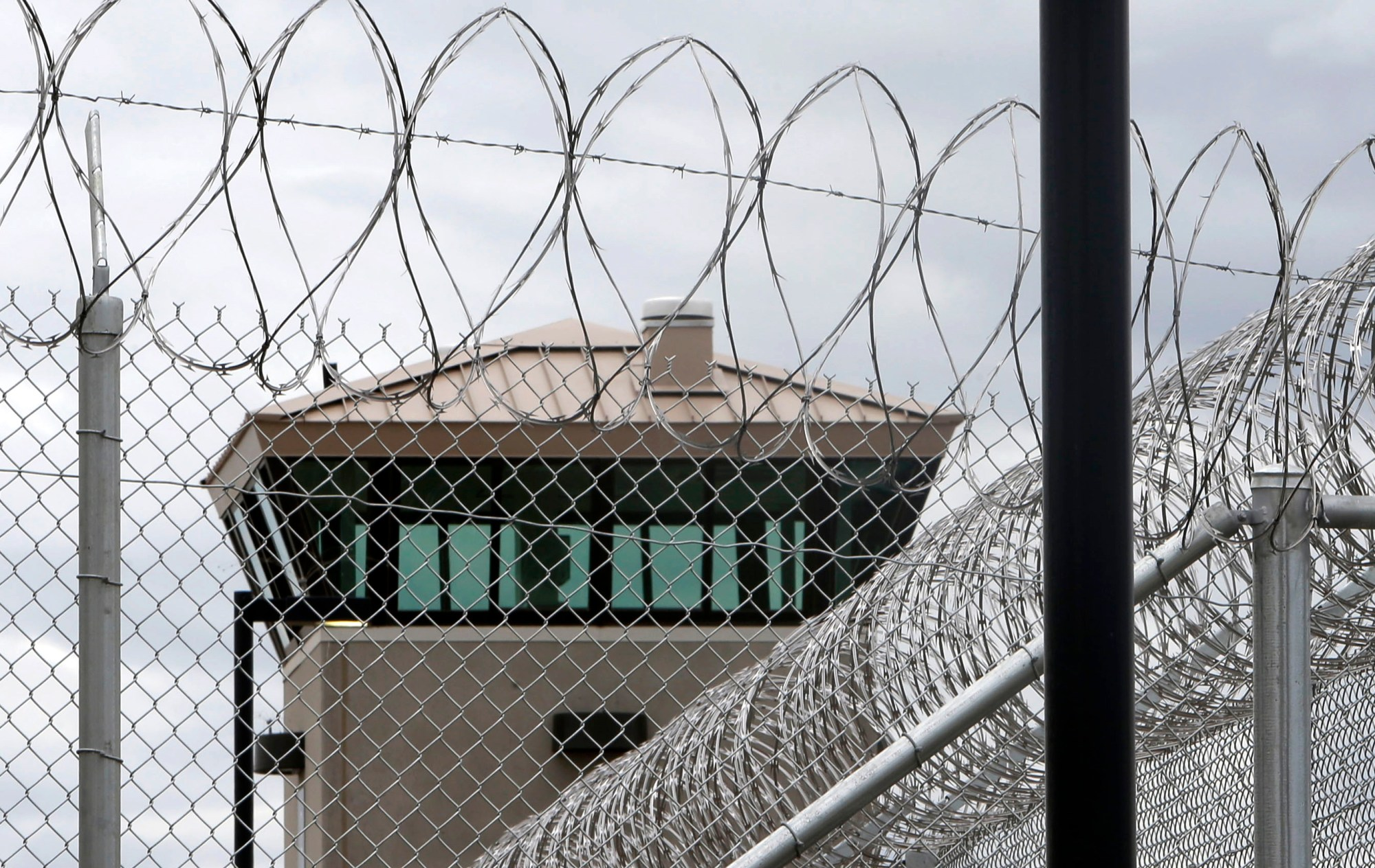 This June 25, 2013 file photo shows a guard tower over the fence surrounding the new California Correctional Health Care Facility in Stockton, Calif. (AP Photo/Rich Pedroncelli,File)