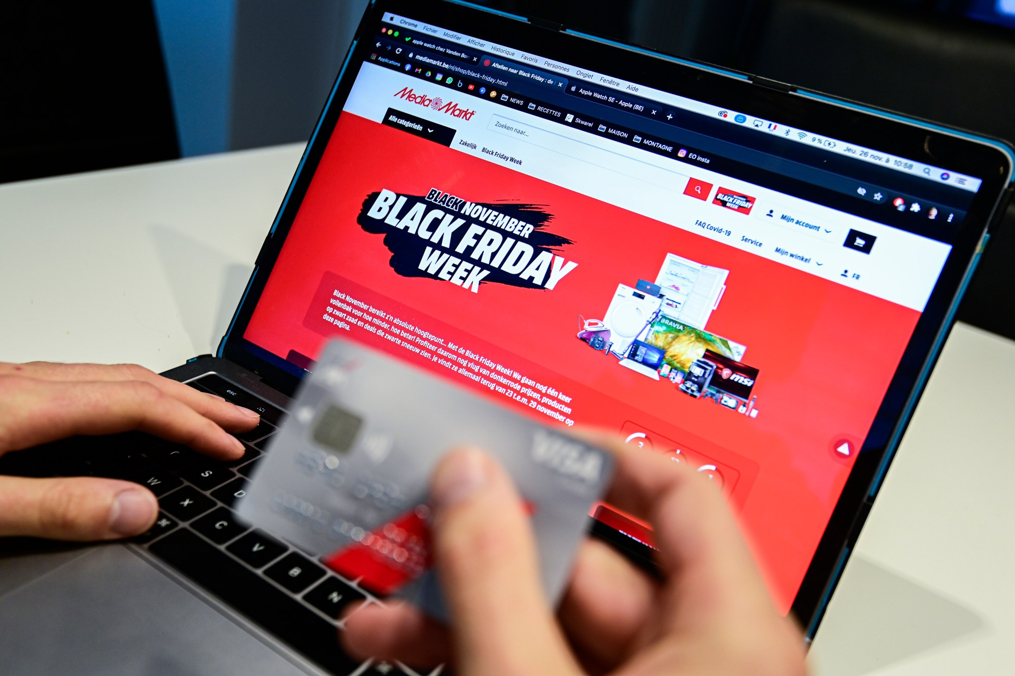 Illustration picture shows a person shopping online, during a Black Friday sale event, on Nov. 26, 2020. (LAURIE DIEFFEMBACQ/BELGA MAG/AFP via Getty Images)