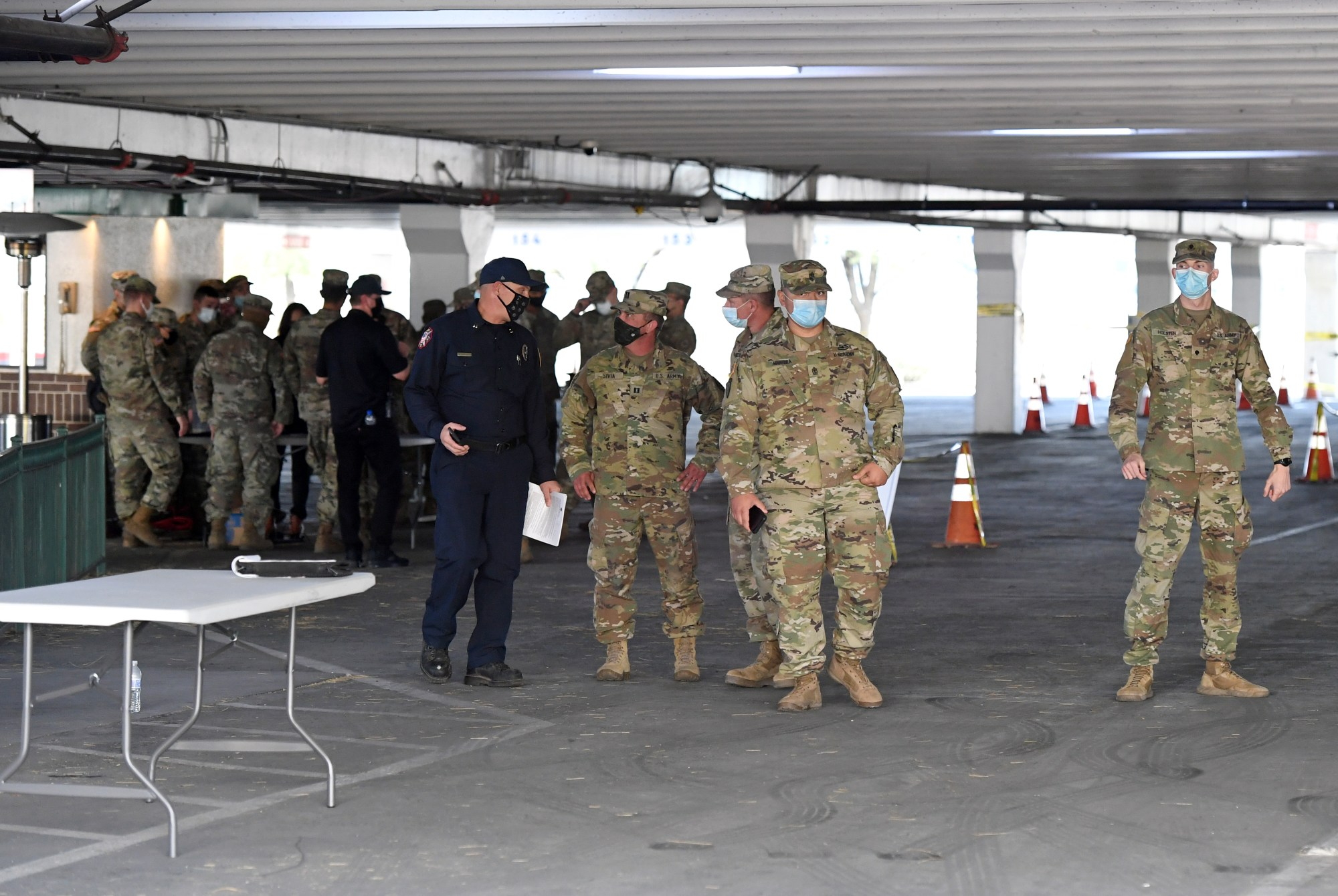Members of the Nevada National Guard and the Clark County Fire Department set up a COVID-19 testing site in the parking garage of the Texas Station Gambling Hall & Hotel on Nov. 12, 2020, in North Las Vegas, Nevada. (Ethan Miller/Getty Images)