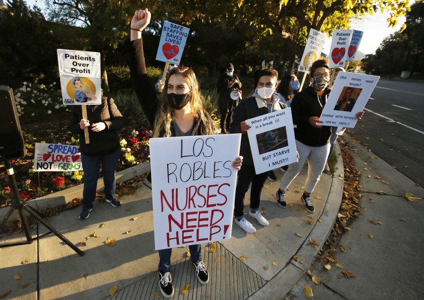 Nurse Cianna Christopher joins other medical professionals in a demonstration outside Los Robles Regional Medical Center in Thousand Oaks.(Al Seib / Los Angeles Times)