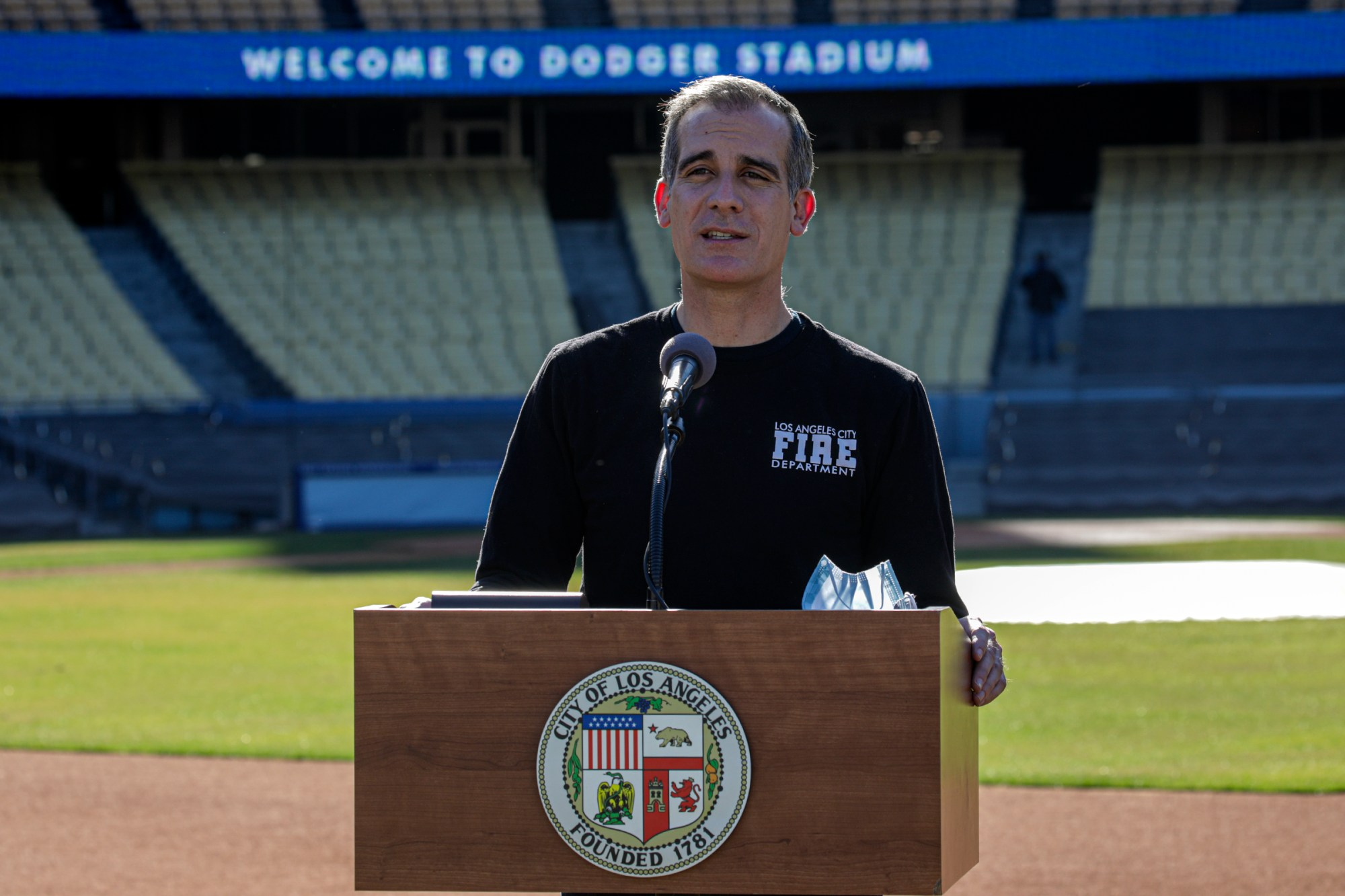 Los Angeles Mayor Eric Garcetti addresses a press conference held at the launch of a mass COVID-19 vaccination site at Dodger Stadium on Jan. 15, 2021. (Irfan Khan / AFP / Getty Images)