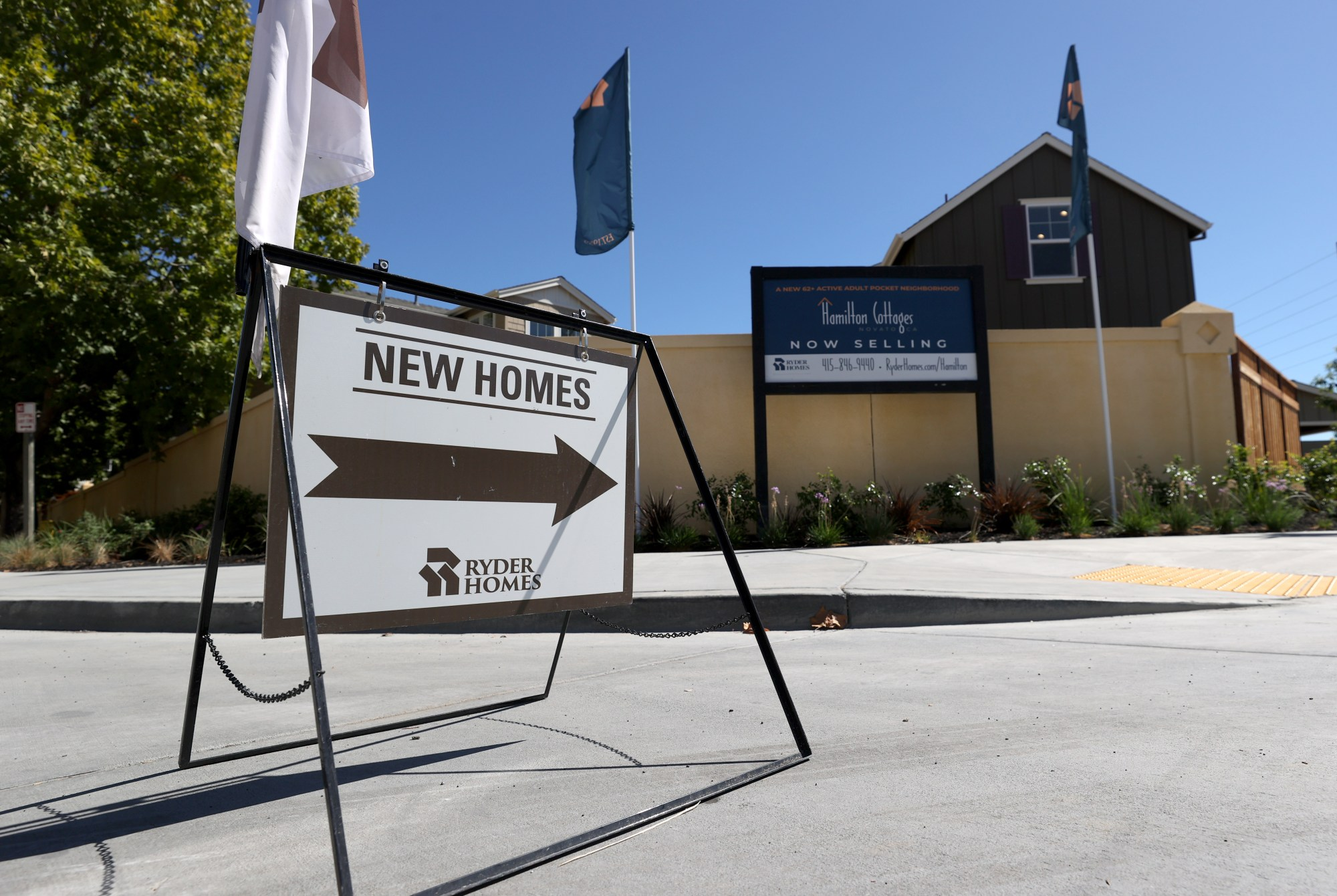 A sign is posted in front of new homes for sale at Hamilton Cottages on Sept. 24, 2020 in Novato. (Justin Sullivan/Getty Images)