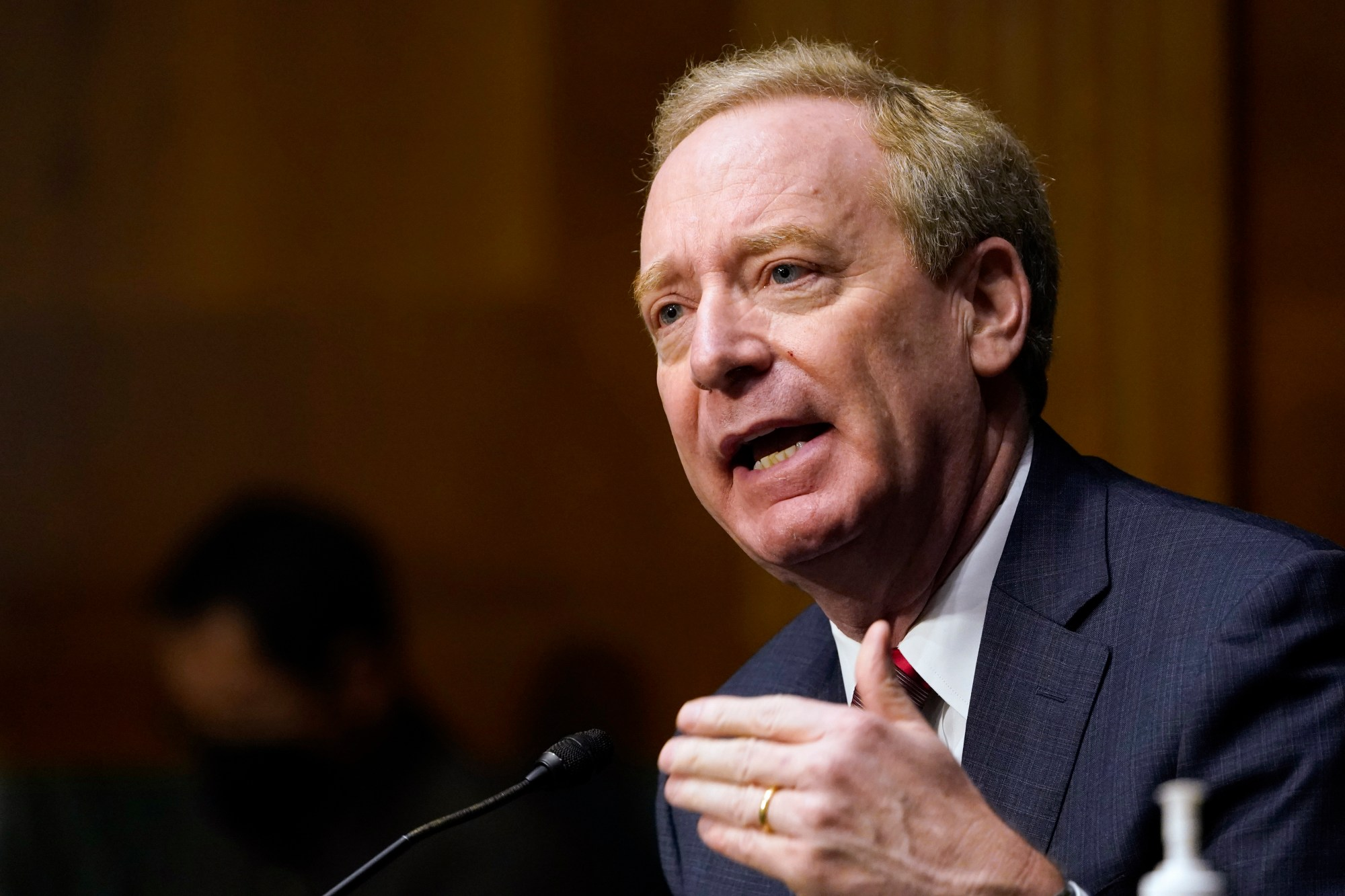 In this Feb. 23, 2021, file photo Brad Smith, president of Microsoft Corporation, speaks on Capitol Hill in Washington during a hearing on emerging technologies and their impact on national security. (AP Photo/Susan Walsh, File)