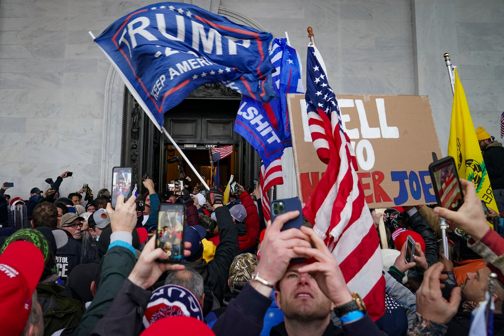 In this Jan. 6, 2021, file photo, Trump supporters gather outside the Capitol in Washington. Some people charged with storming the U.S. Capitol on Jan. 6 are claiming they were only there to record history as journalists, not join a deadly insurrection. Experts say it's unlikely that they can mount a viable defense on First Amendment free speech grounds, but some appear intent on trying. (AP Photo/John Minchillo, File)