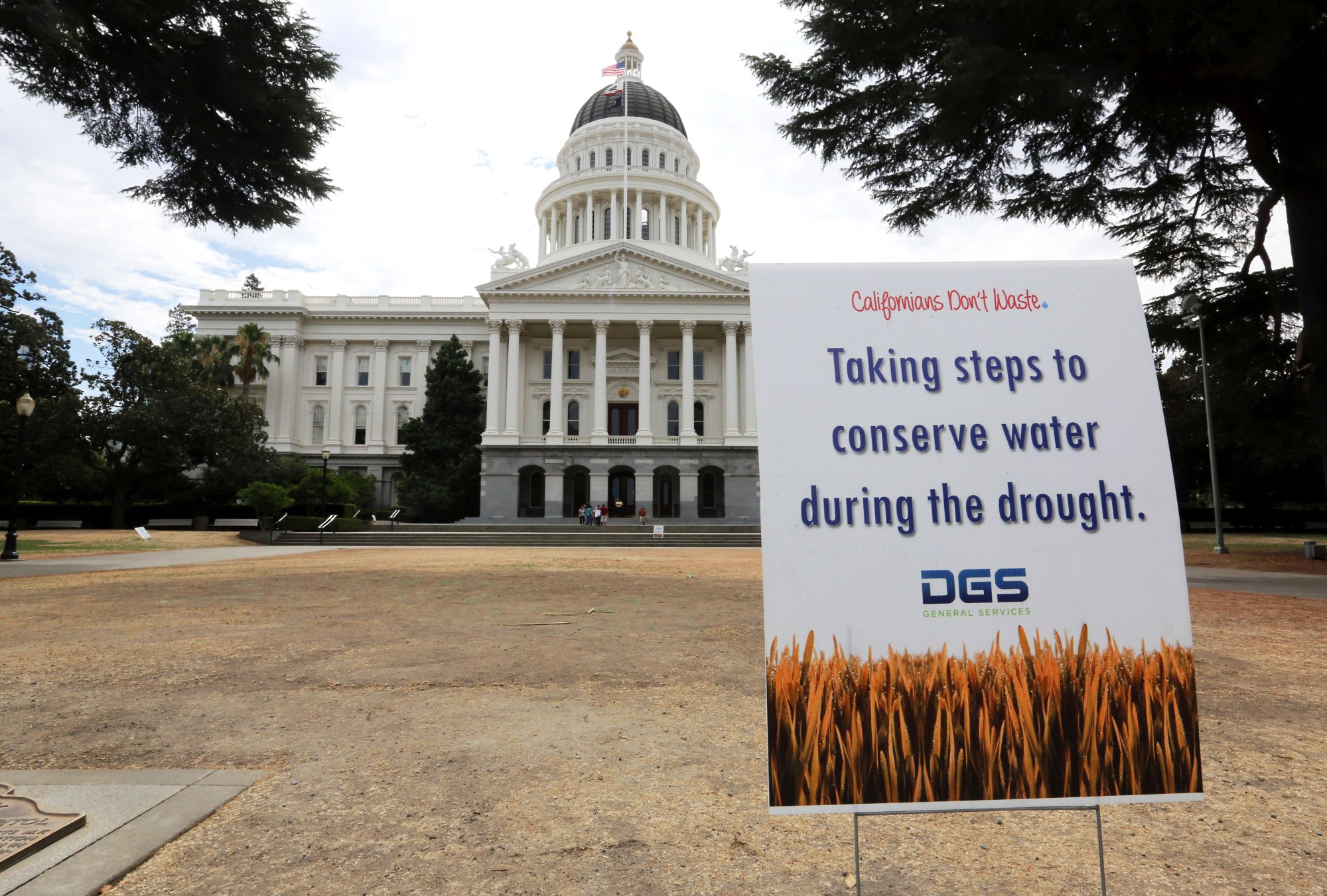 In this July 8, 2014, file photo, is a sign alerting visitors to water conservation efforts at the state Capitol in Sacramento. On April 21, 2021, Calif. Gov. Gavin Newsom declared an emergency executive order in two Northern California counties in response to drought conditions affecting much of the state. The announcement affects Mendocino and Sonoma counties, where Newsom said drought conditions are especially bad. (AP Photo/Rich Pedroncelli, File)