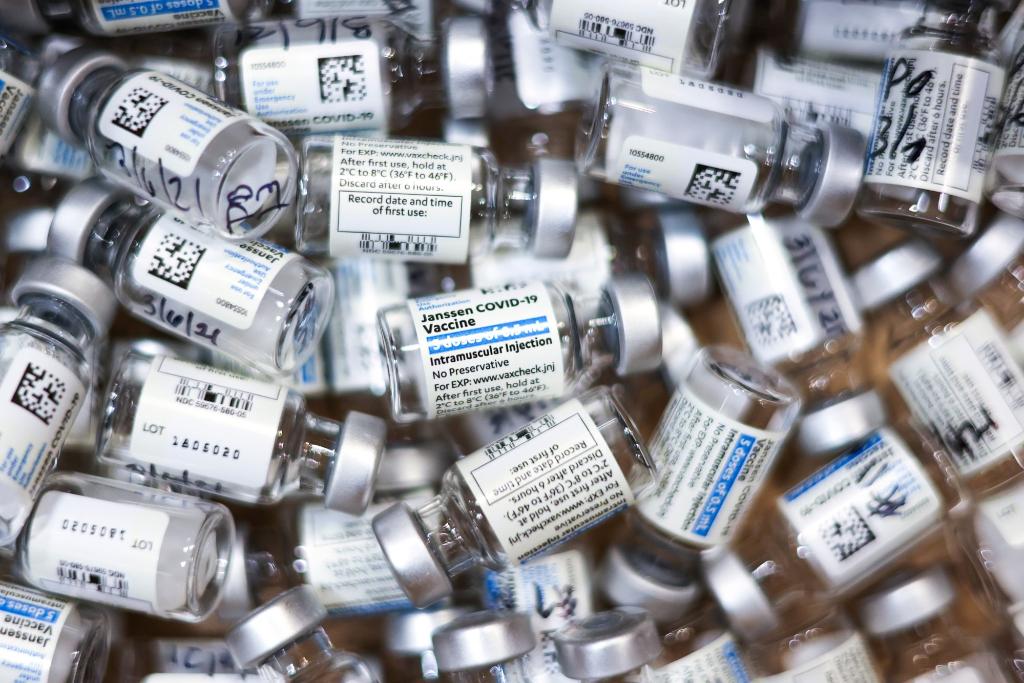 Used vials of the Johnson & Johnson COVID-19 vaccine sit in a box at an event put on by the Thornton Fire Department on March 6, 2021 in Thornton, Colorado. (Michael Ciaglo/Getty Images)