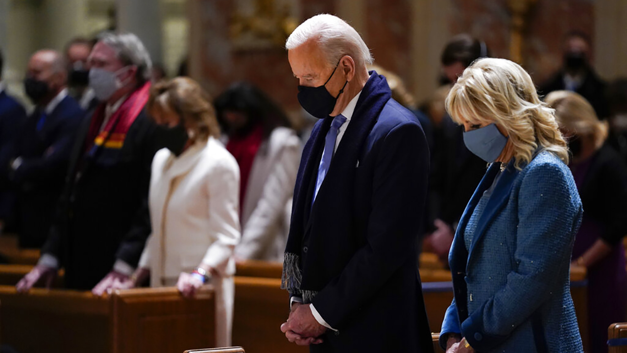 President-elect Joe Biden and his wife, Jill Biden, attend Mass at the Cathedral of St. Matthew the Apostle during Inauguration Day ceremonies in Washington on Jan 20, 2021. (Evan Vucci / Associated Press)