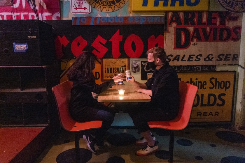 Jasmine Aguilar and Adam Ziegenhals of Echo Park have drinks at the Ham and Eggs bar in Los Angeles. (Francine Orr / Los Angeles Times)