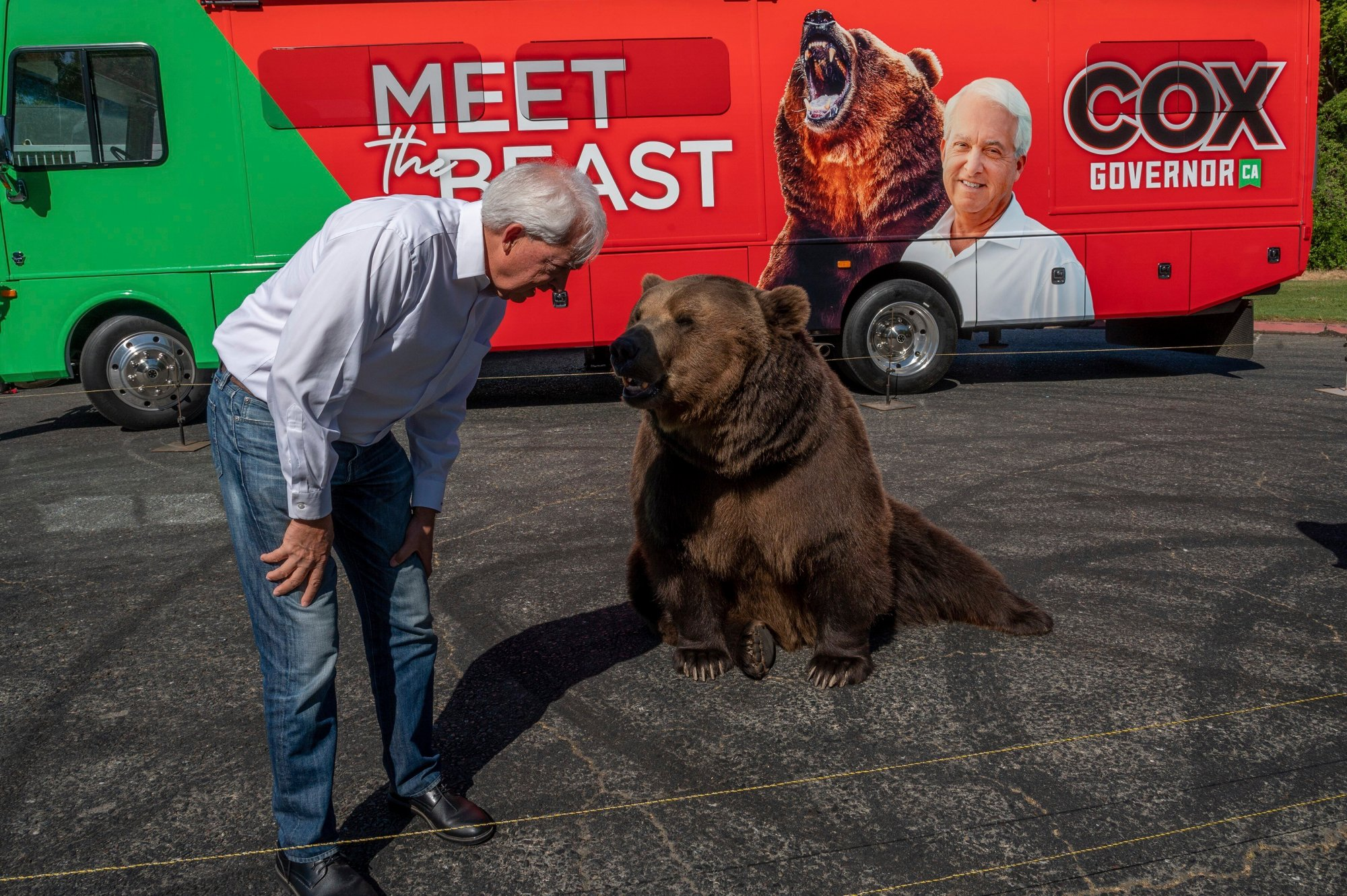 "John Cox, Republican recall candidate for California governor, begins his statewide ""Meet the Beast"" bus tour on May 4, 2021, with Tag, a Kodiak brown bear, at Miller Regional Park in Sacramento. (Renee C. Byer / The Sacramento Bee via Associated Press)"