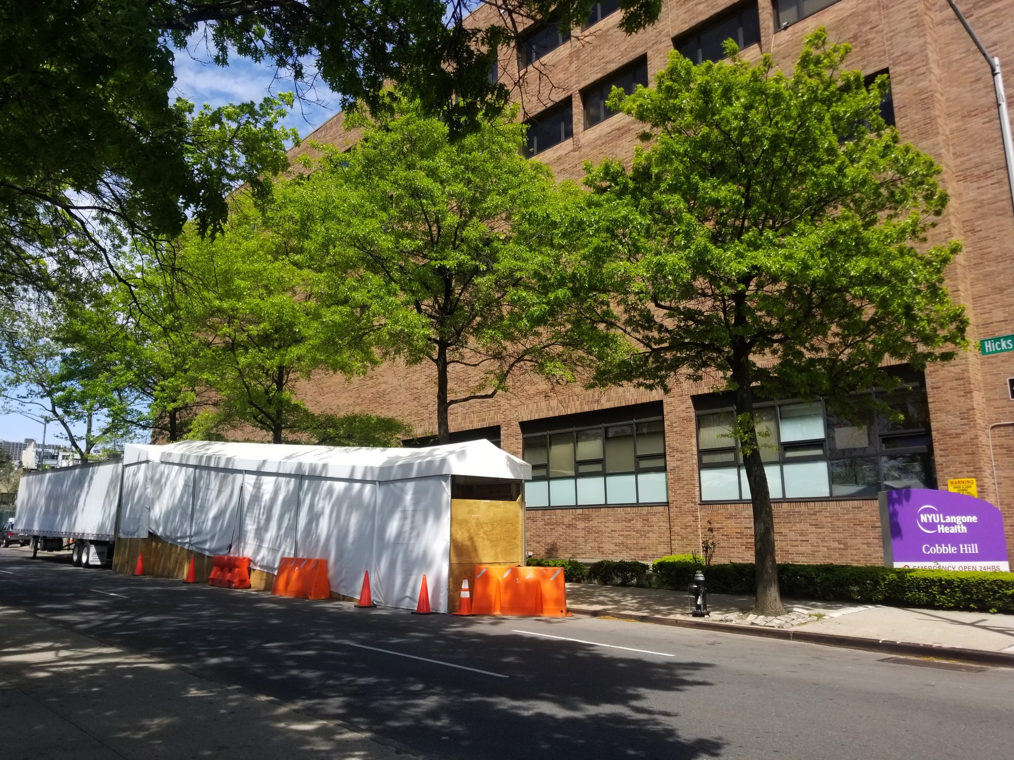 A refrigerated truck serving as makeshift morgue is seen outside of NYU Langone Health Cobble Hill emergency department during the coronavirus pandemic on May 17, 2020 in the Cobble Hill neighborhood of the Brooklyn borough of New York City. (Justin Heiman/Getty Images)