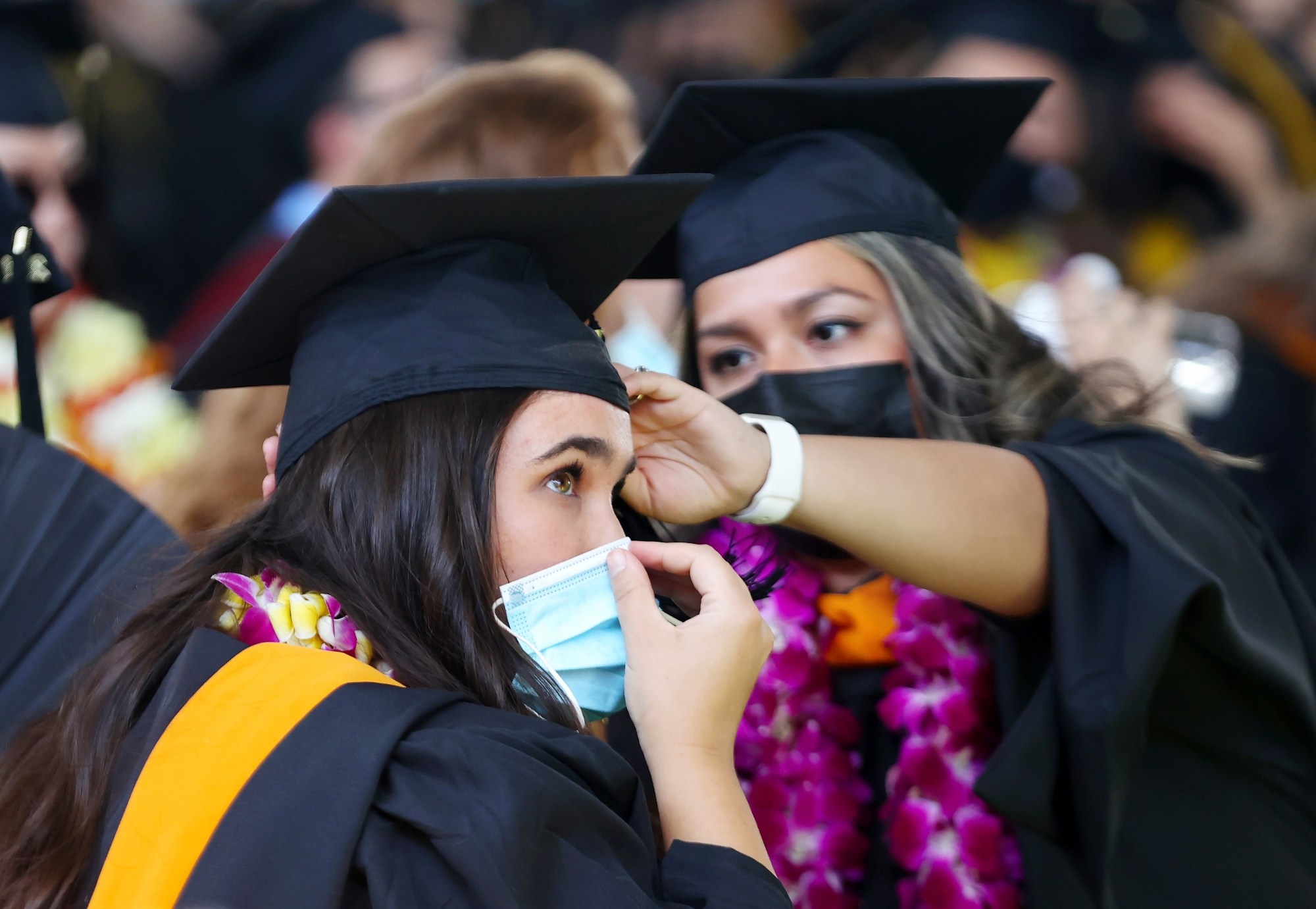 Cal State Los Angeles graduates prepare for their commencement ceremony, which was held outdoors beneath a tent on campus on July 27, 2021. Commencement ceremonies for graduates from the classes of 2021 and 2020 are being held outdoors over seven days following delays due to the COVID-19 pandemic. (Mario Tama / Getty Images)