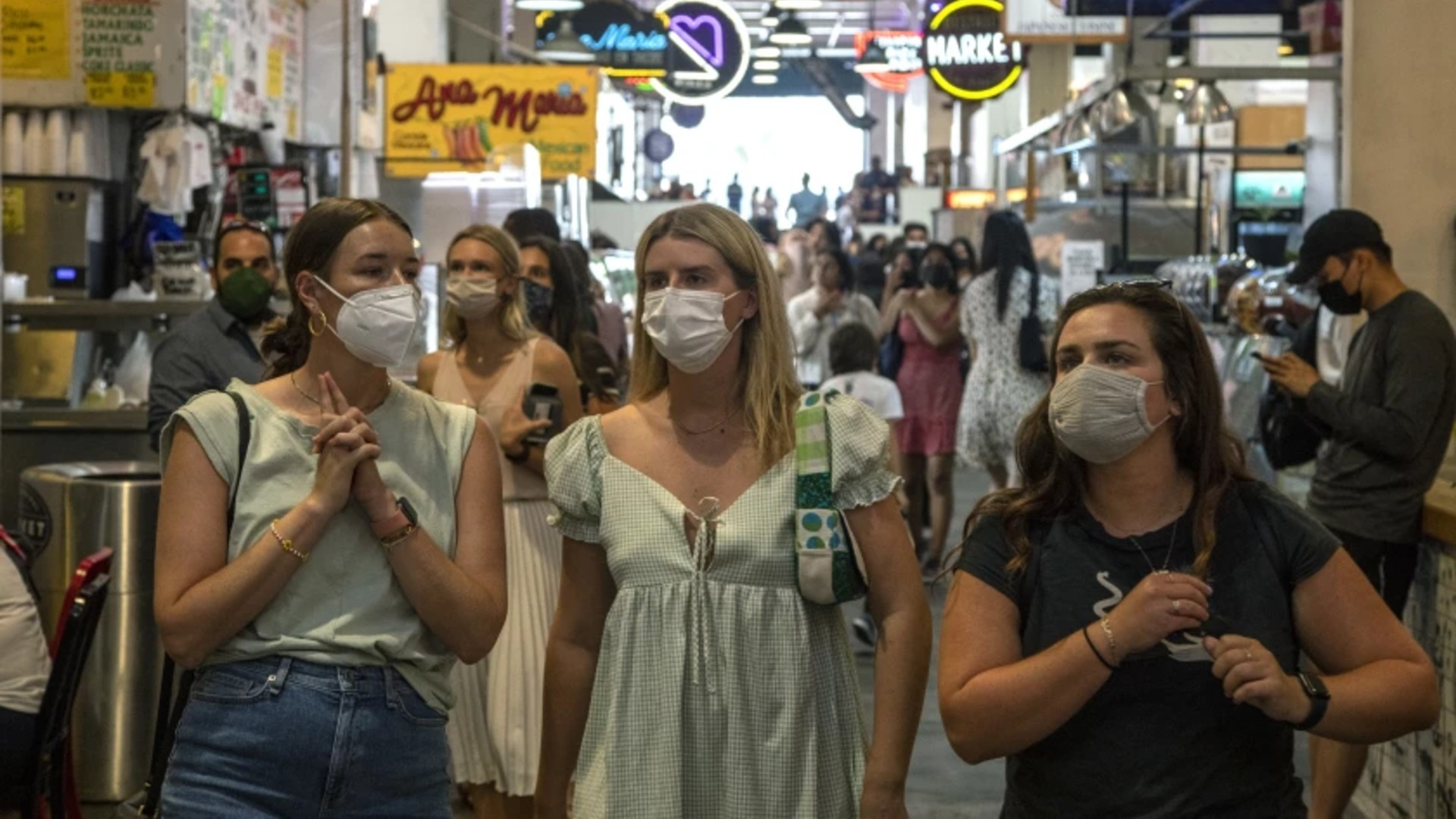 Visitors to the Grand Central Market in Los Angeles were mostly masked on Tuesday.(Brian van der Brug / Los Angeles Times)