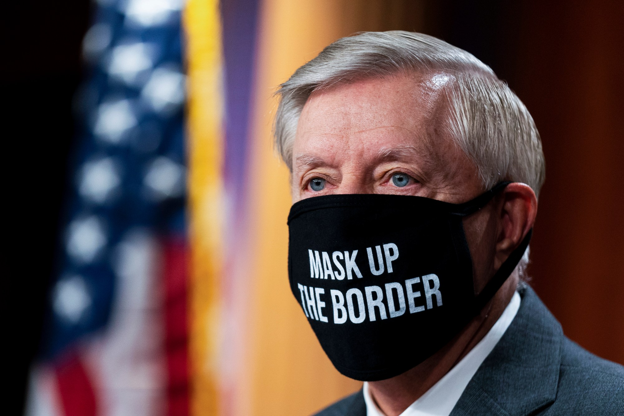 Sen. Lindsey Graham, R-S.C., wearing a mask, takes a pause at the start of a news conference about the United States/Mexico border at the Capitol in Washington, Friday, July 30, 2021. (AP Photo/Manuel Balce Ceneta)