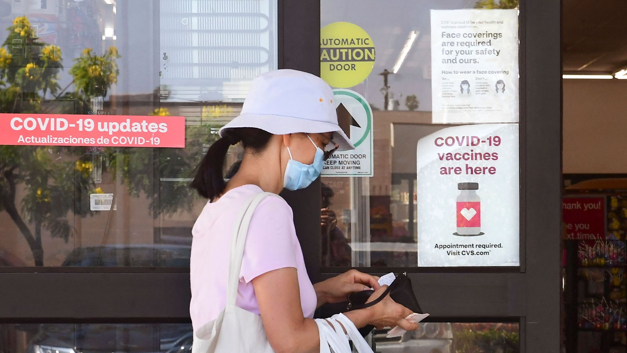 A woman enters a CVS drugstore in Monterey Park, California, where Covid-19 vaccines are being offered on July 27, 2021. - Los Angeles County is seeing a rapid increase in new daily Covid cases due to the Delta variant as hospitalizations increase. (Photo by Frederic J. BROWN / AFP) (Photo by FREDERIC J. BROWN/AFP via Getty Images)