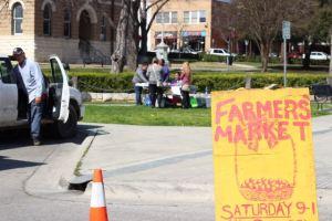 A Farmer's Market sign.