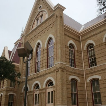 Old Main side view. Photo by Nathalie Cohetero