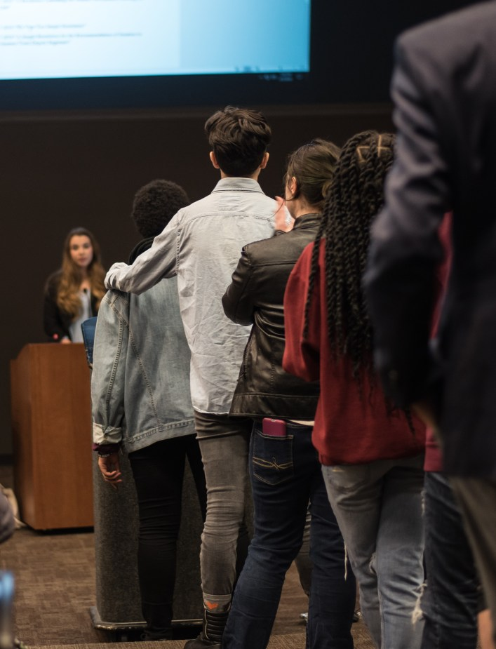 One student offers another support as they share their thoughts and struggles as minority students on campus