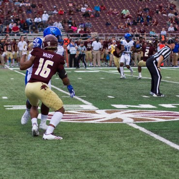 Jashon Waddy, number 16, combats a white jersey, blue-helmeted Georgia State wide receiver, number 45, on the peripheral of the field. Last season, Waddy was a cornerback who fought with an urgent physicality; him leading in that same style will be a major factor against the New Mexico State spread.