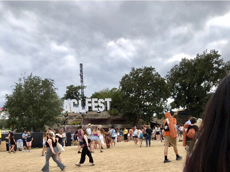 """People walking near a sign that says """"ACL Fest"""""""