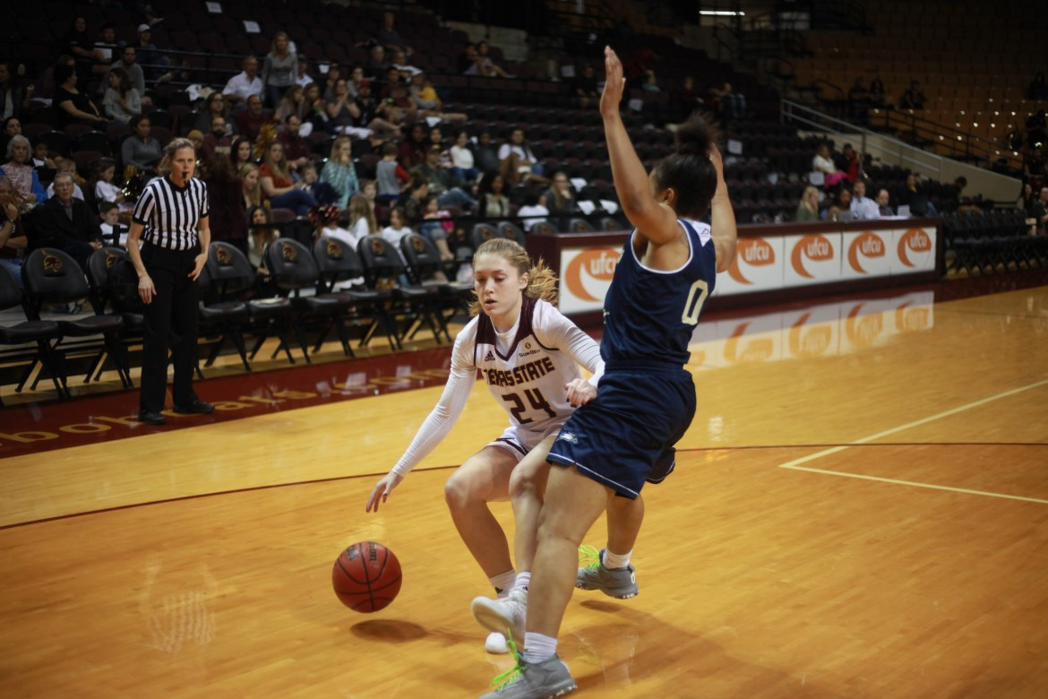 Brooke Holle goes up against a South Alabama player.