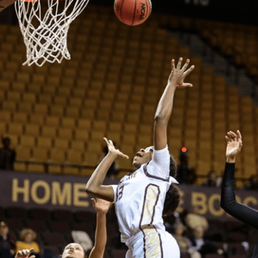 A Texas State player goes for a score against Coastal Carolina.