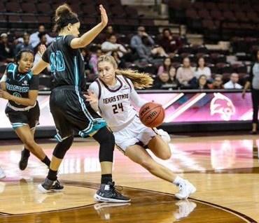 Brooke Holle dodges around a Coastal Carolina player.