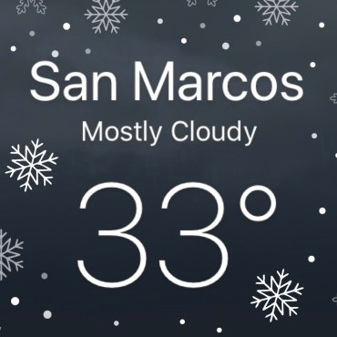 A screenshot of the weather and temperature in San Marcos (Mostly Cloudy, 33 degrees) with snow flurries and snowflakes falling around.