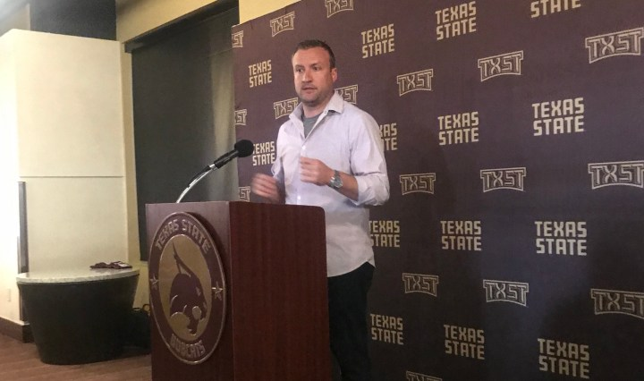 Head Coach Jake Spavital at the podium talking about the Spring game during the post-game conference.
