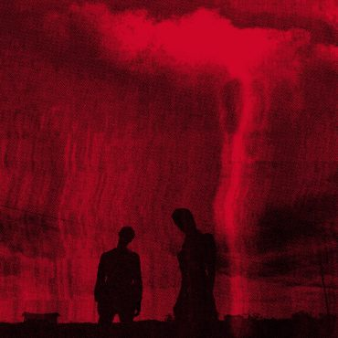 Two silhouettes of people stand in the middle of a dark red background that fills most of the cover.