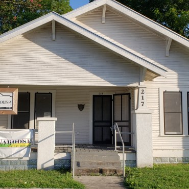 """Small white house with a sign reading """"Cephas House"""" and another reading """"Calaboose African American History Museum."""""""