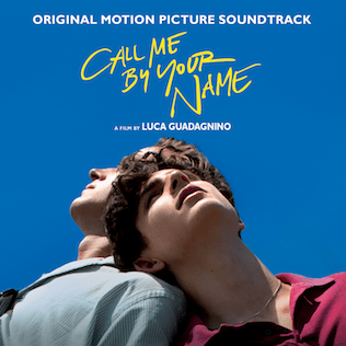 """Two men look into the sky and lean on each other and yellow text says """"Call Me By Your Name."""""""