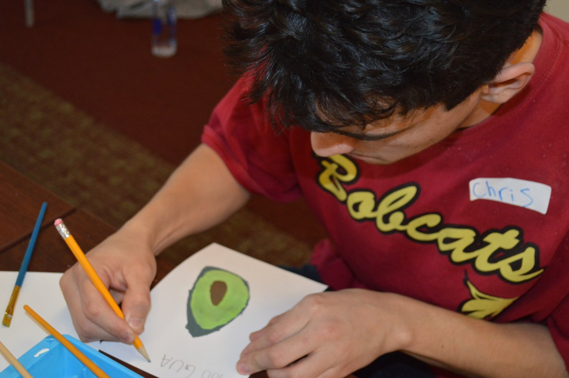 A Creative Cats member making a card with an avocado